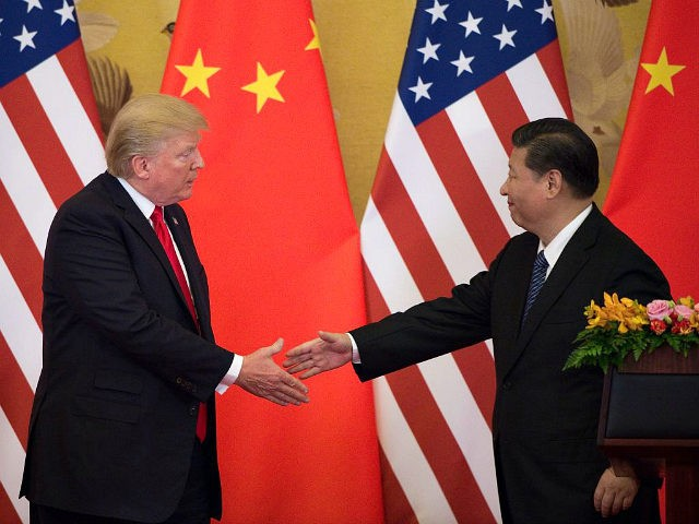 US President Donald Trump (L) shakes hands with China's President Xi Jinping at the end of a press conference at the Great Hall of the People in Beijing on November 9, 2017. Donald Trump urged Chinese leader Xi Jinping to work 'hard' and act fast to help resolve the North …