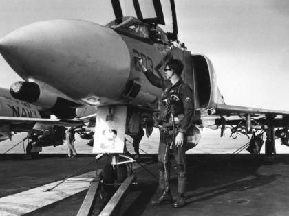 A US pilot touches up the number on a McDonnell Douglas F4 Phantom jet aboard the aircraft carrier Constellation, which is patrolling the Gulf of Tonkin off Vietnam. (Photo by Terry Fincher/Getty Images)