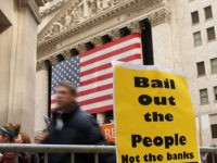 NEW YORK - OCTOBER 24: Protesters gather outside of the New York Stock Exchange October 24, 2008 in New York City. The demonstrators were frustrated with the goverment bailout package and voiced concerns about poor and working class Americans. It was another tumultuous week on Wall St. with the Dow …