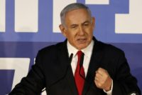 Netanyahu defiant after decision to indict him ahead of polls
