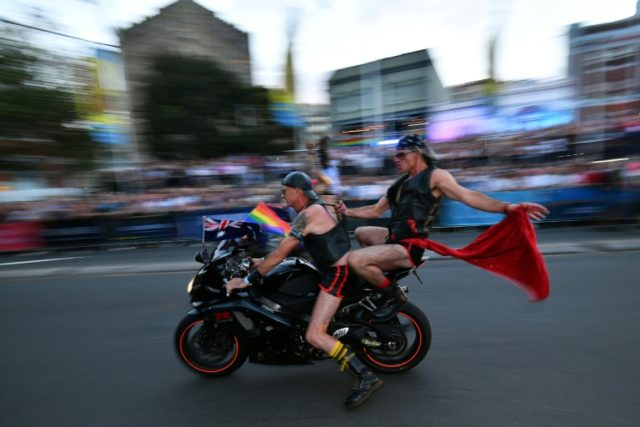 People participate in a motorcycle rally during the annual Gay and Lesbian Mardi Gras parade in Sydney