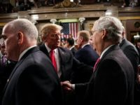 "Senator Mitch McConnell, seen here shaking President Donald Trump's hand on February 5, 2019, said he believes the upper chamber will vote to reject the president's ""national emergency"" to fund construction of a border wall"
