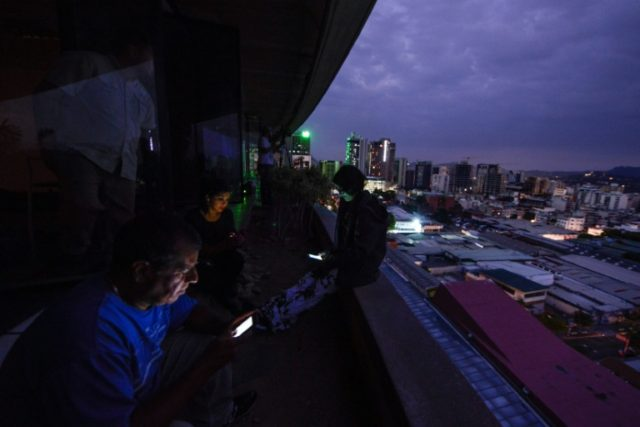 Blackout darkens much of Venezuela in latest taste of economic woes