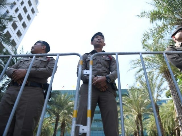 Policemen stand guard outside the Constitutional Court in Bangkok on Thursday ahead of a court ruling on the Thai Raksa Chart party