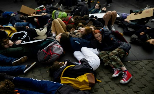 Students at U.N. Stage 'Die-in' to Protest Climate Inaction…