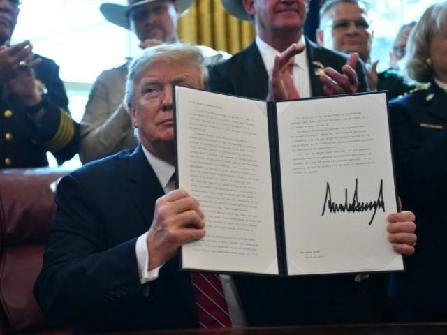 Trump signs first veto to secure funding for border wall