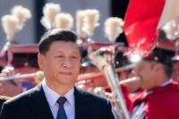 China's Xi insists new Silk Road runs both ways as Italy signs up