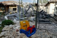 Rare rocket strike near Tel Aviv wounds Israelis, Netanyahu to return