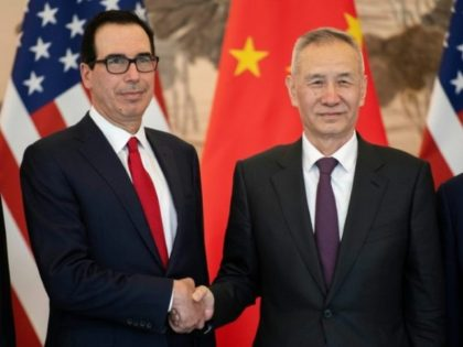China's Vice Premier Liu He (R) shakes hands with US Treasury Secretary Steven Mnuchin (L) as they pose for a group photo at the Diaoyutai State Guesthouse in Beijing