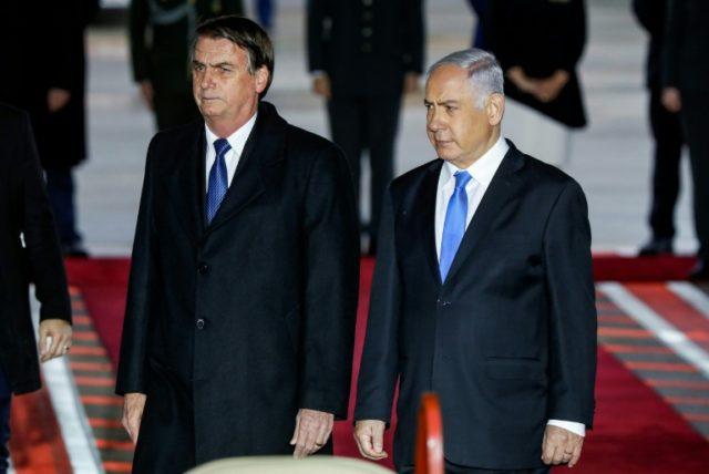 Brazilian President Jair Bolsonaro (L) was greeted on arrival in Israel by Prime Minister Benjamin Netanyahu