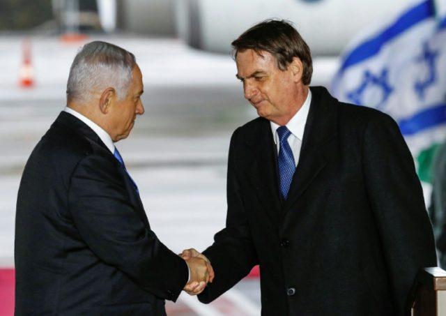 Brazilian President Jair Bolsonaro (R) was greeted on arrival in Israel by Prime Minister Benjamin Netanyahu
