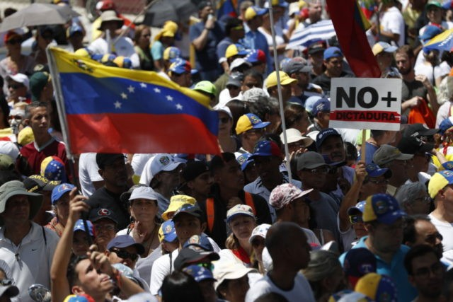 Guaido arrives in Venezuela as supporters gather to protest