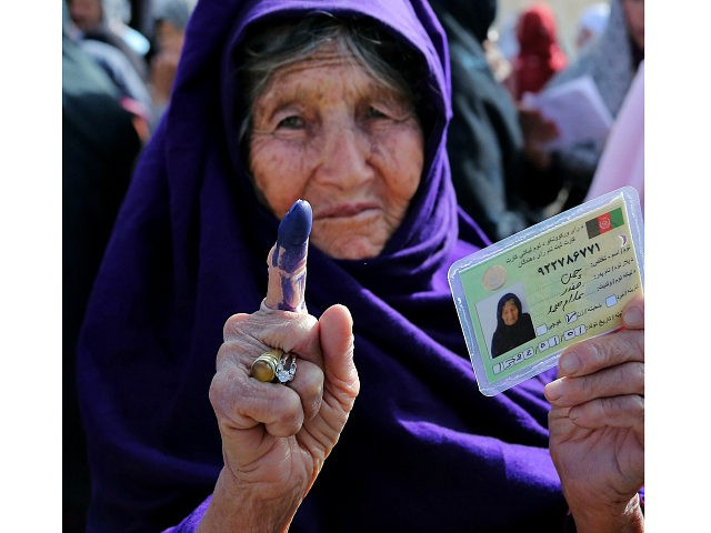 An elderly female Afghan voter shows her inked finger after she cast her ballot at a local polling station in Ghazni on April 5, 2014. Afghan voters went to the polls to choose a successor to President Hamid Karzai, braving Taliban threats in a landmark election held as US-led forces …
