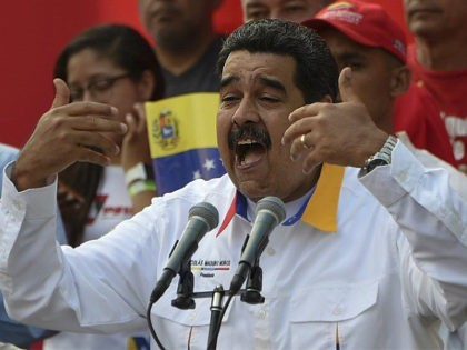 Venezuelan President Nicolas Maduro delivers a speech during a pro-government demonstration in Caracas on March 23, 2019. - It is two months since Juan Guaido has asserted he is Venezuela's interim president. Domestically, he has been unable to shake President Nicolas Maduro from power. (Photo by Juan BARRETO / AFP) …
