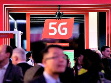 People walk by a 5G stand at the Mobile World Congress (MWC), the world's biggest mobile fair, on February 26, 2018 in Barcelona. JOSEP LAGO/AFP/Getty Images
