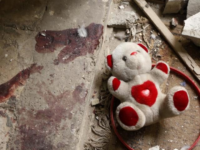 Teddy Bear at crime scene. (AP File Photo/Hadi Mizban)