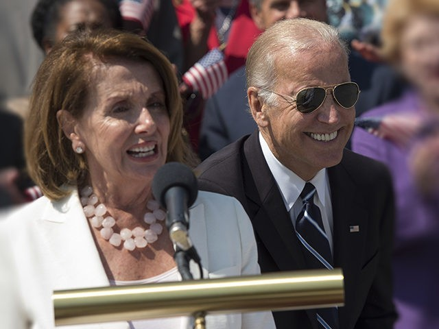 Vice President Joe Biden greets Senate Minority Leader Harry Reid of Nev. as House Minority Leader Nancy Pelosi of Calif. speaks on the House steps of the Capitol in Washington, Thursday, Sept. 8, 2016, during a rally urging Republicans to join with Democrats to take meaningful action to confront the …