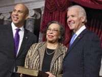 Newly-elected Democratic senator from New Jersey, former Newark Mayor Cory Booker, left, poses for an official photographer with his mother, Carolyn Booker, center, and Vice President Joe Biden, acting in his Constitution role as president of the Senate, at the Capitol in Washington, Thursday, Oct. 31, 2013. (AP Photo/J. Scott …