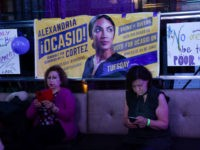 People check the latest mid-terms results on thier phones while celebrating Alexandria Ocasio-Cortez congressional race big win during her election night party in the Queens Borough of New York on November 6, 2018. - 28-year-old Alexandria Ocasio-Cortez from New Yorks 14th Congressional district won Tuesdays election, defeating Republican Anthony Pappas. …