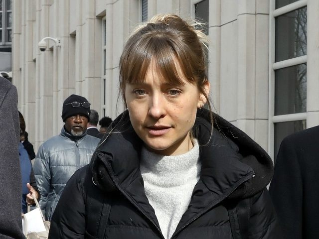 Allison Mack leaves Brooklyn federal court, in New York, Wednesday, Feb. 6, 2019. She is a co-defendant in a case against an upstate New York group called NXIVM, accused of branding some of its female followers and forcing them into unwanted sex. (AP Photo/Richard Drew)