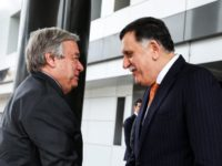 Libyan unity government Prime Minister Fayez al-Sarraj (R) shakes hands with United Nations Secretary General Antonio Guterres at his office in the Libyan capital Tripoli on April 4, 2019. (Photo by - / AFP) (Photo credit should read -/AFP/Getty Images)
