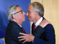 European Commission president Jean-Claude Juncker (L) greets Former British prime minister Tony Blair upon his arrival for a meeting at the European Commission in Brussels on August 31, 2017
