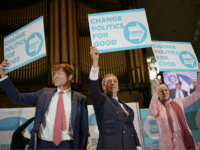 NOTTINGHAM, ENGLAND - APRIL 20: Brexit party chairman Richard Tice (L), Nigel Farage and Annunziata Rees-Mogg wave placards at the end of the Brexit Party rally at the Albert Hall conference centre on April 20, 2019 in Nottingham, England. Farage, the former leader of the U.K. Independence Party, has launched …