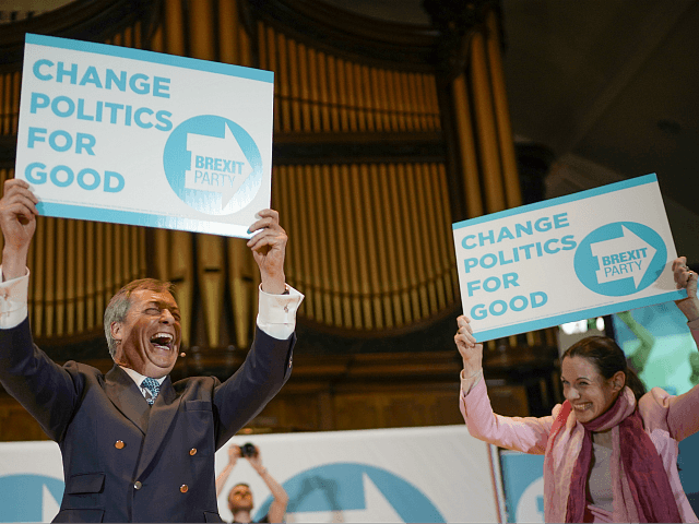 NOTTINGHAM, ENGLAND - APRIL 20: Annunziata Rees-Mogg, sister of Jacob Rees Mogg, a freelance journalist and candidate for the Brexit Party in the European Parliament elections, and Nigel Farage wave party placrds at the Brexit Party rally at the Albert Hall conference centre on April 20, 2019 in Nottingham, England. …
