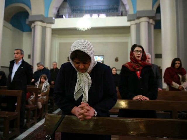Iranian Christian worshippers attend the Christmas mass at the Saint Joseph Chaldean-Assyrian Catholic church, in Tehran, Iran, Monday, Dec. 25, 2017. Iranian Christians are a minority and recognized by the constitution in the Muslim country and are represented in the parliament. (AP Photo/Vahid Salemi)