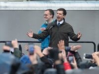 Chasten Glezman (L) joins his husband South Bend Mayor Pete Buttigieg on stage as they greet an overflow crowd at a rally where Buttigieg announced that he will be seeking the Democratic nomination for president on April 14, 2019 in South Bend, Indiana. Buttigieg has been drumming up support for …