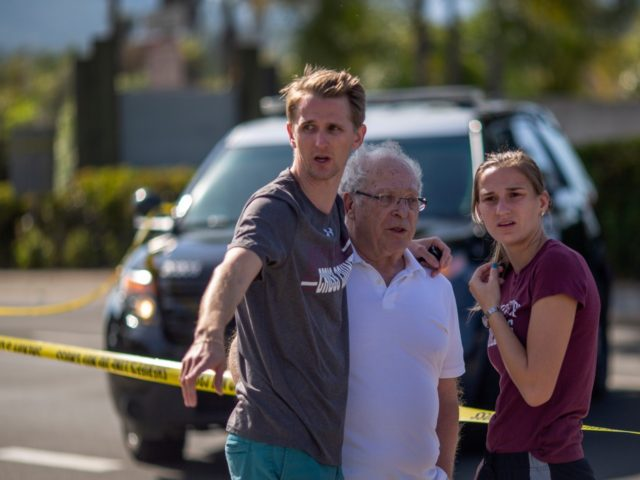 POWAY, CA - APRIL 27: People embrace outside the Congregation Chabad synagogue on April 27, 2019 in Poway, California. A gunman opened fire at the synagogue on the last day of Passover leaving one person dead and three others injured. The suspect is in custody. (Photo by David McNew/Getty Images)