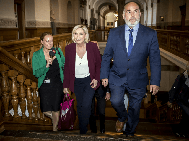 Head of France's National Rally Marine Le Pen, centre, walks with Denmark politician Soeren Espersen, right who is chairman of the Foreign Policy Committee, during a visit to Christiansborg Palace in Copenhagen, Denmark, Friday April 26, 2019. (Mads Claus Rasmussen/Ritzau Scanpix via AP)