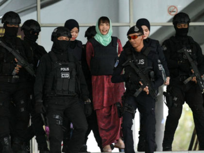 Vietnamese national Doan Thi Huong (C) is escorted by Malaysian police out of the High Court in Shah Alam on April 1, 2019. - A Vietnamese woman accused of assassinating the North Korean leader's half-brother was sentenced to three years and four months in jail after accepting a lesser charge …