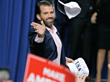 Donald Trump Jr. tosses hats to the crowd before speaking ahead of his father President Donald Trump at a Make America Great Again rally Saturday, April 27, 2019, in Green Bay, Wis. (AP Photo/Mike Roemer)