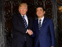 US President Donald Trump greets Japanese Prime Minister Shinzo Abe as he arrives for talks at Trump's Mar-a-Lago resort in Palm Beach, Florida, on April 17, 2018. / AFP PHOTO / MANDEL NGAN (Photo credit should read MANDEL NGAN/AFP/Getty Images)