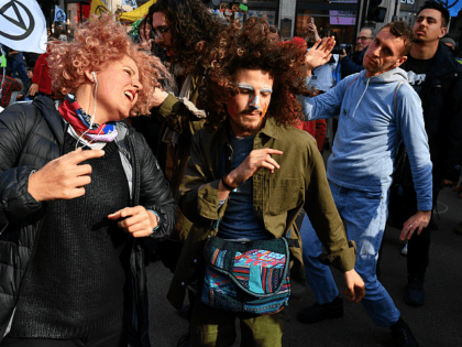LONDON, ENGLAND - APRIL 15: Environmental campaigners block Oxford Circus during a coordinated protest by the Extinction Rebellion group on April 15, 2019 in London, England. With demonstrations blocking a number of locations across the capital, the group aims to stop traffic for up to five days. (Photo by Leon …