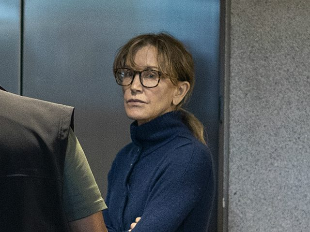 TOPSHOT - Actress Felicity Huffman is seen inside the Edward R. Roybal Federal Building and U.S. Courthouse in Los Angeles, on March 12, 2019. - Two Hollywood actresses including Oscar-nominated 'Desperate Housewives' star Felicity Huffman are among 50 people indicted in a nationwide university admissions scam, court records unsealed in …