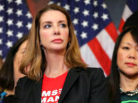 WASHINGTON, DC - JANUARY 08: Founder of Moms Demand Action for Gun Sense founder Shannon Watts joins other gun safety advocates for a news conference to introduce legislation to expand background checks for firearm sales in the Rayburn Room of the U.S. Capitol January 08, 2019 in Washington, DC. Eight …