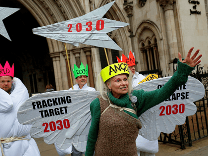 TOPSHOT - British fashion designer Vivienne Westwood, dressed as an angel, poses with other anti-fracking activists, dressed as Joseph, and the three wise men, as the demonstrate outside the Royal Courts of Justice, Britain's High Court, in central London on December 18, 2018. - Anti-fracking activists, including Talk Fracking, of …