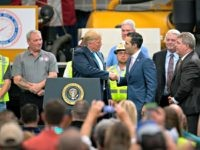 President Donald Trump shakes hands with Texas Land Commissioner George P. Bush at the International Union of Operating Engineers International Training and Education Center Wednesday, April 10, 2019, in Crosby, Texas. (AP Photo/Juan DeLeon)