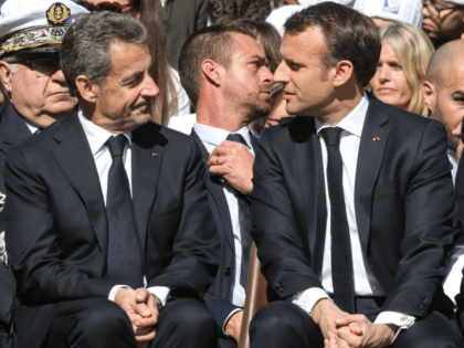 French President Emmanuel Macron (R) and his predecessor Nicolas Sarkozy attend a ceremony in tribute to World War II resistance fighters killed at the plateau des Glieres, near Thorens-Glieres in the French Alps, on March 31, 2019. (Photo by ludovic MARIN / POOL / AFP) (Photo credit should read LUDOVIC …