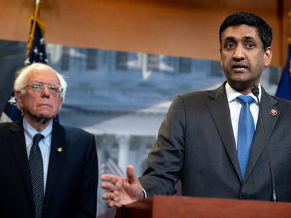US Representative Ro Khanna (R), Democrat of California, and US Senator Bernie Sanders, Independent of Vermont, speak during a press conference following a vote in the US House on ending US military involvement in the war in Yemen, on Capitol Hill in Washington, DC, April 4, 2019. (Photo by SAUL …