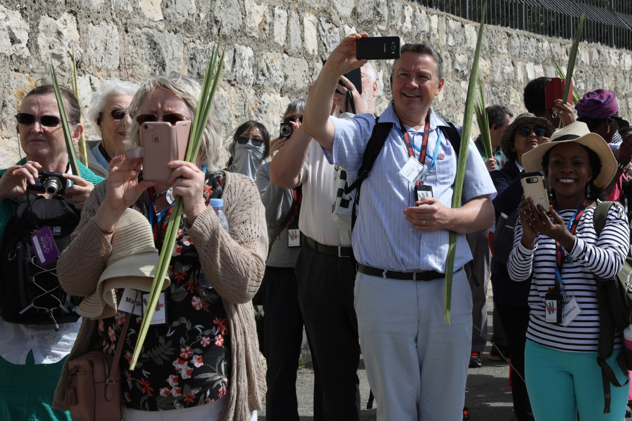 Catholic worshippers take part in the traditional Palm Sunday procession from the Mount of Olives to Jerusalem's Old City on April 14, 2019. - The ceremony is a landmark in the Christian calendar, marking the triumphant return of Christ to Jerusalem the week before his death, when a cheering crowd greeted him waving palm leaves. Palm Sunday marks the start of the most solemn week in the Christian calendar. (Photo by GALI TIBBON / AFP) (Photo credit should read GALI TIBBON/AFP/Getty Images)