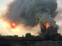 Flames and smoke are seen billowing from the roof at Notre-Dame Cathedral in Paris on April 15, 2019. - A fire broke out at the landmark Notre-Dame Cathedral in central Paris, potentially involving renovation works being carried out at the site, the fire service said.Images posted on social media showed …