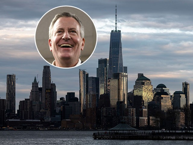 (INSET: Bill de Blasio) A man jogs in front of the skyline of lower Manhattan on April 16, 2019 in New York City. (Photo by Johannes EISELE / AFP) (Photo credit should read JOHANNES EISELE/AFP/Getty Images)