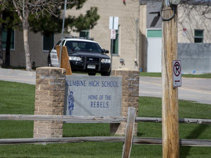 Police patrol outside a locked Columbine High School on April 17, 2019 in Littleton, Colorado, as all Denver-area schools were evacuated and classes cancelled after an active threat to the area made by Sol Pais. - A US teenager has been found dead after a massive search by authorities who …