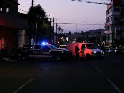 Mexican municipal police investigate a crime scene. (File Photo: GUILLERMO ARIAS/AFP/Getty Images)