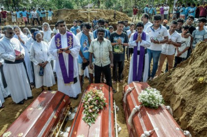 COLOMBO, SRI LANKA - APRIL 23: Relatives of the dead offer their prayers during funerals in Katuwapity village on April 23, 2019 in Negambo, Sri Lanka. At least 311 people were killed with hundreds more injured after coordinated attacks on churches and hotels on Easter Sunday rocked three churches and …