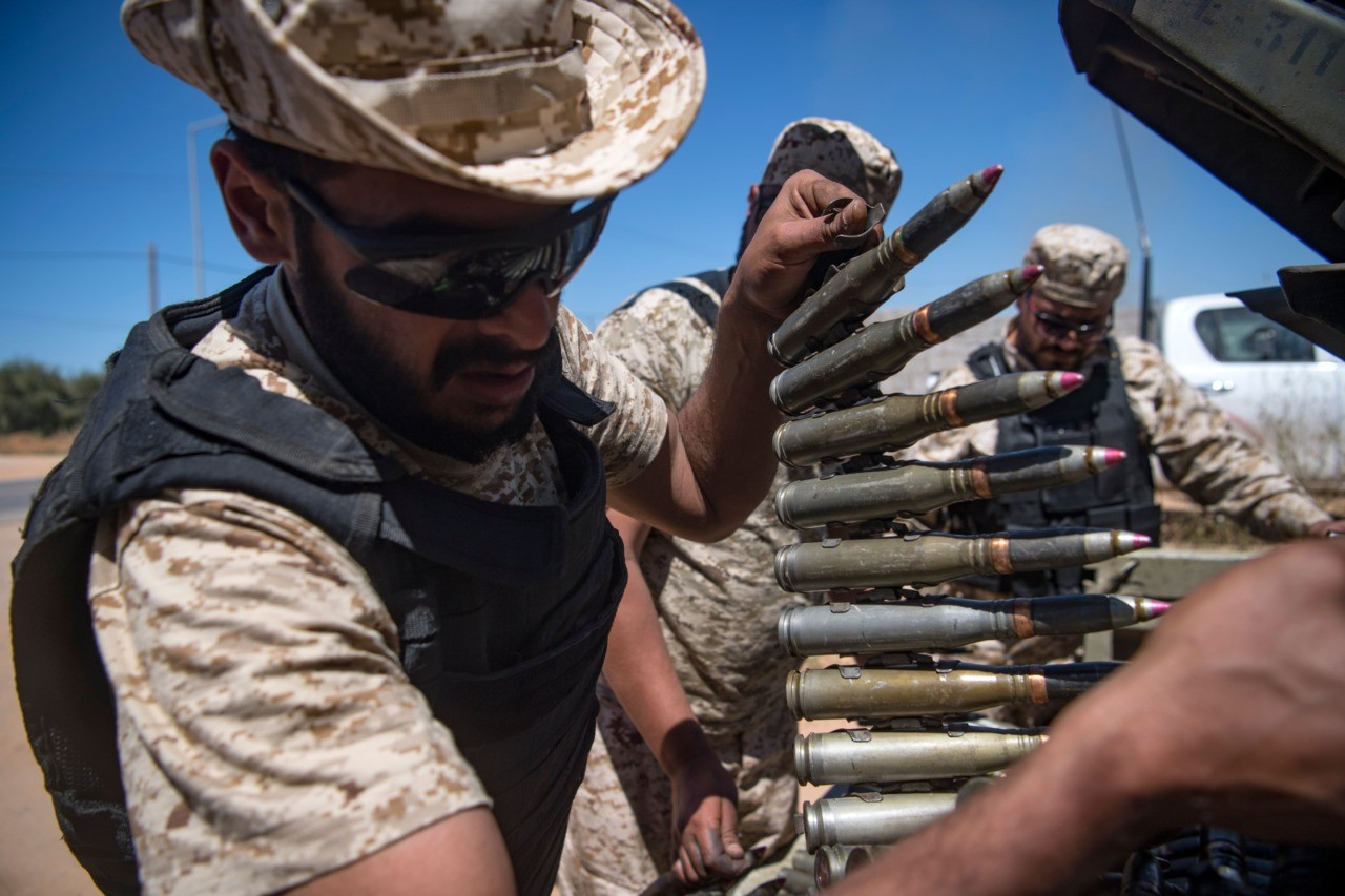 A fighter loyal to the internationally-recognised Government of National Accord (GNA) carries a bullet belt as he and fellow fighters hold a position during clashes with forces loyal to strongman Khalifa Haftar, in Espiaa, about 40 kilometres (25 miles) south of the Libyan capital Tripoli on April 29, 2019. - Fierce fighting for control of Libya's capital that has already displaced tens of thousands of people threatens to bring a further worsening of humanitarian conditions, a senior UN official has warned. (Photo by Fadel SENNA / AFP) (Photo credit should read FADEL SENNA/AFP/Getty Images)