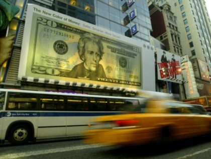 NEW YORK CITY - OCTOBER 9: The new design for the twenty dollar bill is displayed on a billboard near Times Square October 9, 2003 in New York City. The new currency includes improved security features and subtle background colors of green, peach and blue to help prevent and detect …